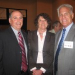 Richard Sleasman, SIOR, Maureen D. Wilson, CCIM, SIOR, talk with Geoff Kreusser, SIOR President